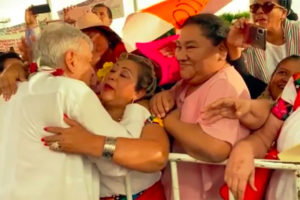AMLO on tour: hugs for all.