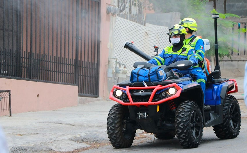 A quad is used to spray a disinfectant in public areas of Santa Catarina, Nuevo León.