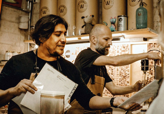 "Brew masters Francisco ""Paco"" Aureliano, left, and Michael Boudey try out a new recipe."