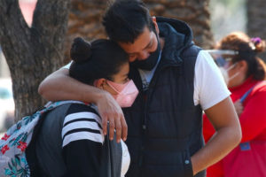 A couple share a moment of grief in Mexico City.