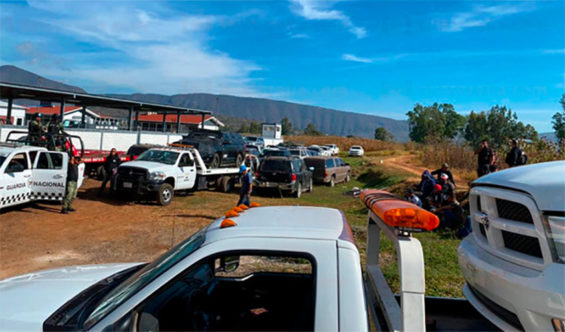 Vehicles abandoned by crime gangs in Michoacán are towed by authorities Thursday.