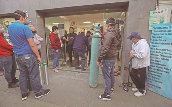 Customers line up for oxygen refills at a Mexico City supplier.