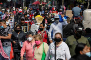 Shoppers filled the streets of downtown Mexico City after Friday's announcement of restrictions.