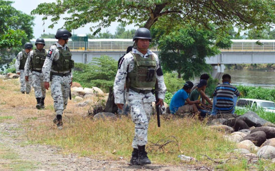 Members of the National Guard patrol the southern border with Guatemala.