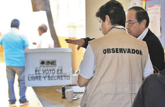 An election observer prepares at a voting station.