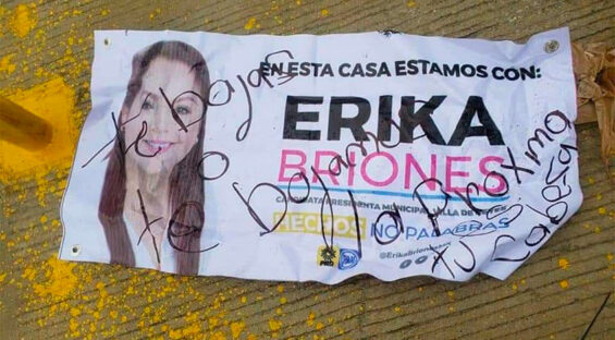 A handwritten message on a campaign leaflet warns that if Briones doesn't step down, her head will be next.